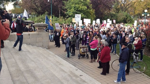 Pro-choice ralliers gather at the Manitoba Legislative Building on Thursday. Anti-abortionists stood across the grounds from them.
