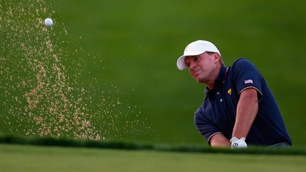 Steve Stricker of the U.S. team hits from the sand during day one at the Muirfield Village Golf Club on October 3, 2013 in Dublin, Ohio.