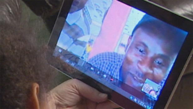 Dwayne Thomas, who is stranded in Jamaica, speaks to his children via Skype.