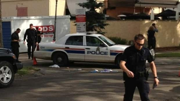 Police are investigating after a man was shot behind Joey's restaurant in downtown Edmonton.