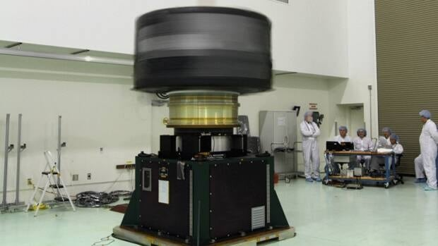 Spacecraft A, one of two Radiation Belt Storm Probes, is checked for proper balance during a spin test. The two probes were launched into space aboard an Atals rocket on Thursday. They will spend two years collecting data from within the Earth's Van Allen radiation belts.