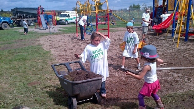 Five-year-old Glenna MacNeil (on the left) and some friends help clean up Louisa Gardens Park in Sydney.
