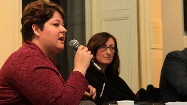 Lisa Hammond, president of the Hamilton-Wentworth unit of the Elementary Teachers' Federation of Ontario, (right) listens to a speakers at a Bill 115 information meeting in November. (Samantha Craggs/CBC)