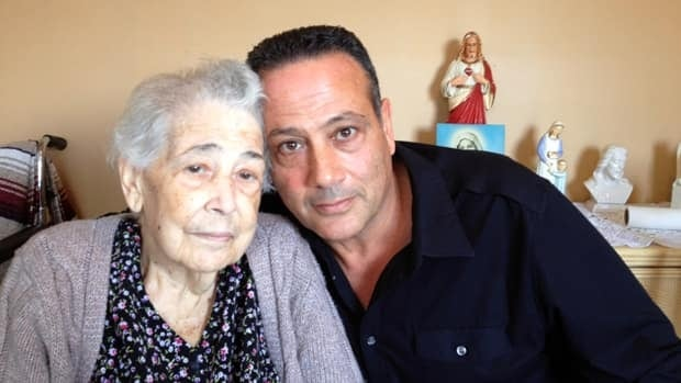 Sarafina Perri and son Joe, some 10 days ago. Her memories of hometown Plati, where bootlegger Rocco Perri grew up, stayed sharp to the end. Her funeral is today.