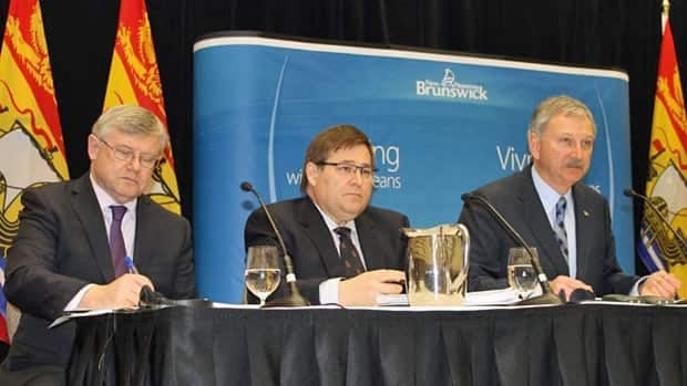 Finance Minister Blaine Higgs, right, outlined his second budget to reporters at a news conference on Tuesday. (Daniel McHardie/CBC)