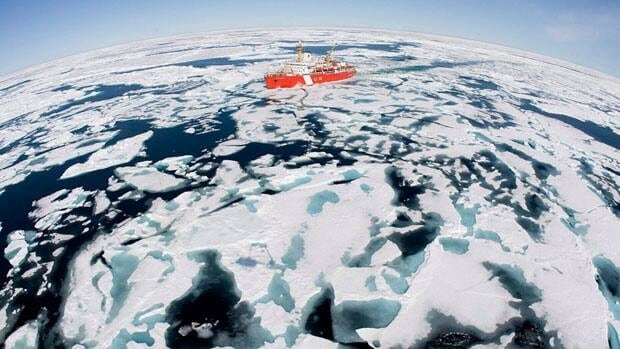 The Canadian Coast Guard icebreaker Louis S. St-Laurent makes its way through the ice in Baffin Bay in this 2008 file photo. The coast guard is taking the brunt of cuts to the Department of Fisheries and Oceans.