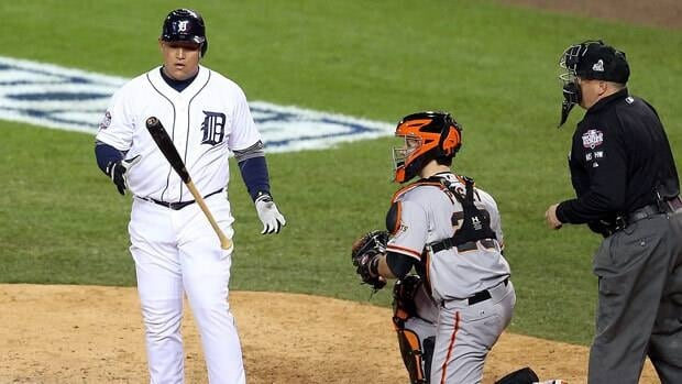Miguel Cabrera of Detroit flips his bat after striking out in the sixth inning of Game 4 against the Giants.