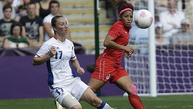 Canada's Desiree Scott battles for the ball against France's Gaetane Thiney during the women's bronze medal soccer match at the 2012 London Summer Olympics on Aug. 9, 2012.
