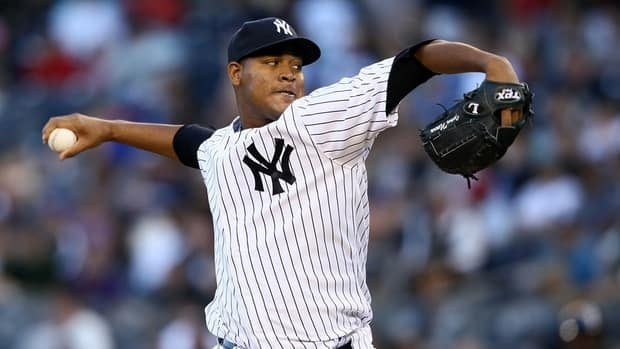 Ivan Nova of the New York Yankees delivers a pitch against the Tampa Bay Rays on September 15, 2012 at Yankee Stadium.