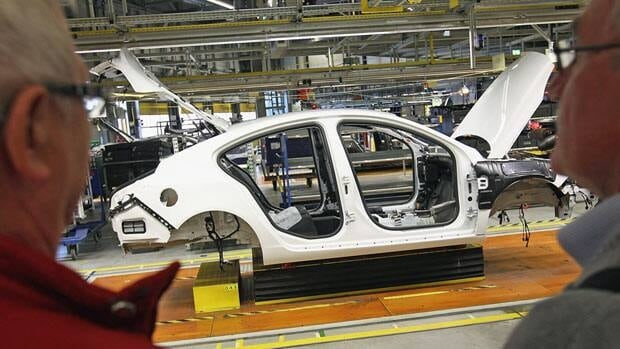 Production is shown on the assembly line of the Opel Insignia in Ruesselsheim, Germany, on Saturday. German business confidence fell for the fifth straight month in September.
