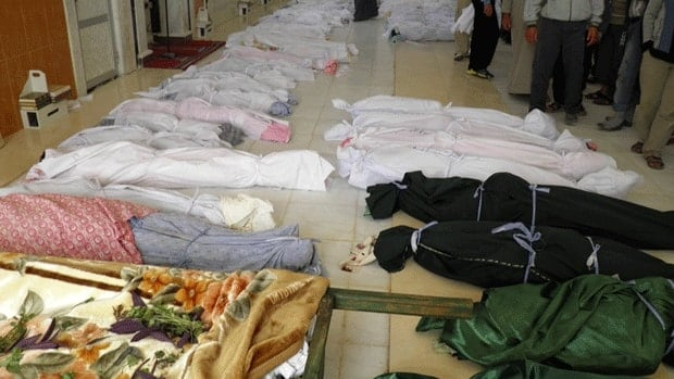 The bodies of people whom anti-government protesters say were killed by government security forces lie on the ground in Houla, in central Syria.