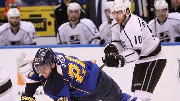 Alex Steen of St. Louis falls after contact from Los Angeles forward Mike Richards during a 2011-12 game.