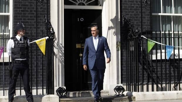 Republican presidential candidate Mitt Romney walks out of 10 Downing Street after meeting with British Prime Minister David Cameron in London on Thursday.