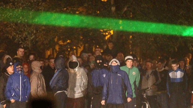 A crowd gathers just before attacking police in North Belfast, Northern Ireland.