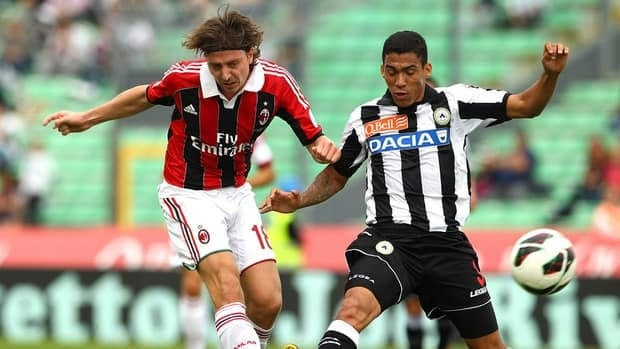 Riccardo Montolivo of AC Milan, left, competes for the ball with Marques Loureiro Allan of Udinese Calcio.