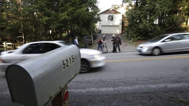 News crews gather as cars pass by the home of U.S. Army Staff Sgt. Robert Bales in Lake Tapps, Wash., on March 16, 2012. Bales is accused of killing 16 Afghan civilians in Afghanistan.