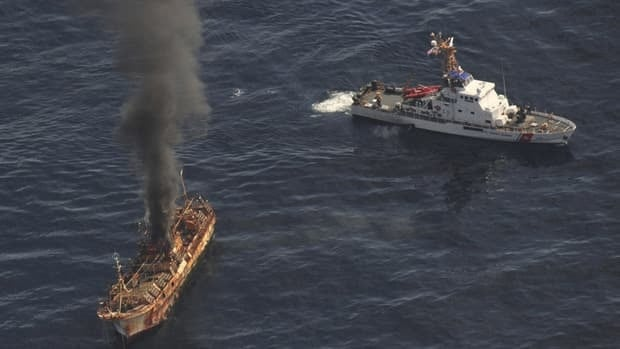Japanese fishing vessel Ryou-Un Maru burns after U.S. Coast Guard Cutter Anacapa crew fired explosive ammunition at the vessel.