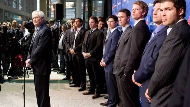 NHLPA executive director Donald Fehr, left, stands in front of players at a press conference in October.