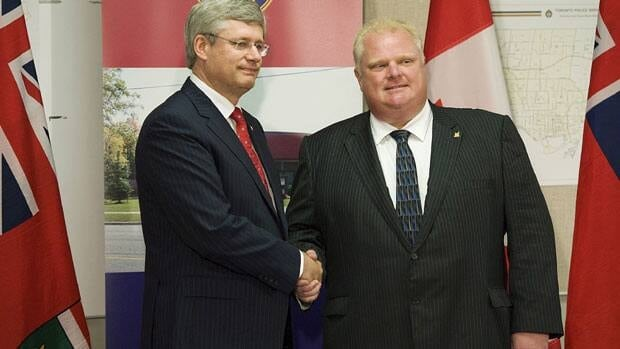 Toronto Mayor Rob Ford, shown with Prime Minister Stephen Harper in August, says the higher levels of government need to help fund Toronto transit expansion.