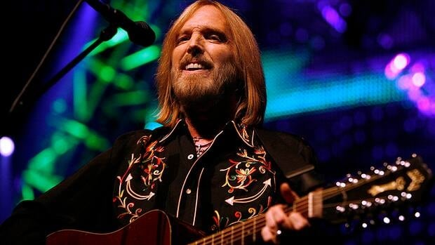 Guitars belonging to Tom Petty, seen performing in 2008, have been recovered and a music studio security guard arrested in connection with the theft.