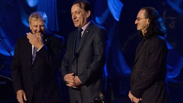 Alex Lifeson, left, Neil Peart, centre, and Geddy Lee of the band Rush are inducted into the Canadian Songwriters Hall of Fame on March 28, 2010. On Tuesday, they were given the Governor General's Award for performing arts.