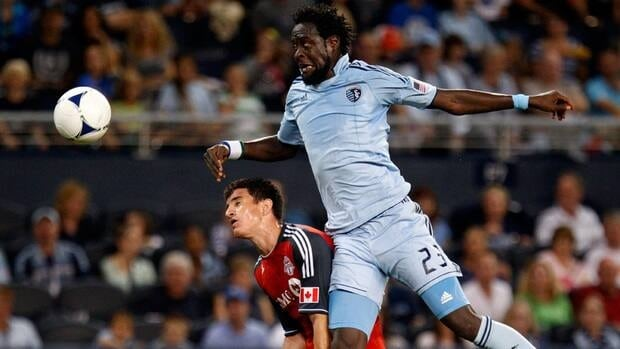 Sporting KC's Kei Kamara tries to head a ball towards the goal over Toronto FC's Logan Emory in the first half at Livestrong Sporting Park on Saturday.