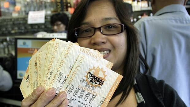 Veronica Balbas holds her Mega Millions lottery tickets for Friday's draw in Lawndale, Calif. on March 29.