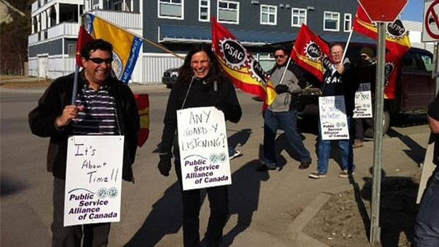 Unionized staff at Many Rivers Counselling Services on the picket line in Whitehorse Monday.