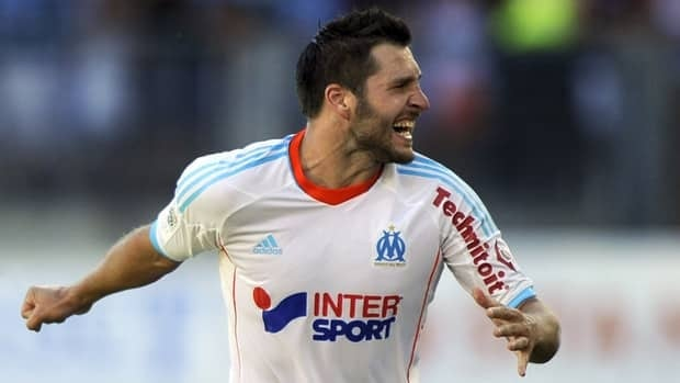 Marseille's Andre-Pierre Gignac celebrates after scoring against Montpellier on August 26, 2012.