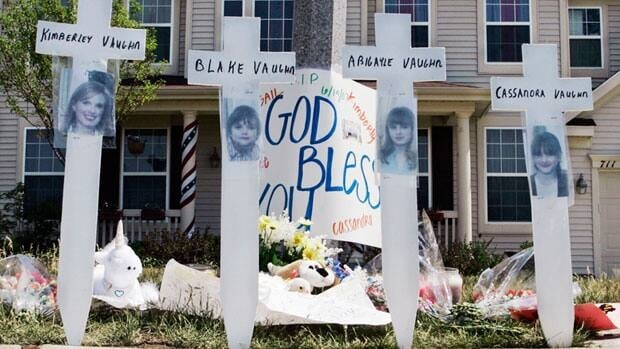 In this June 15, 2007 file photo, a makeshift memorial to Kimberly Vaughn, and her three children Abigayle, 12, Cassandra, 11, and Blake, 8, is seen outside their home in Oswego, Ill.
