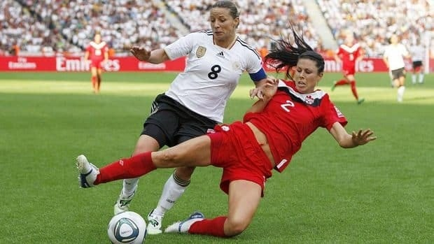 Canadian defender Emily Zurrer vies for the ball against Germany's Inka Grings during the 2011 FIFA Women's World Cup in Germany last June. Zurrer was recently left off Canada's roster for Olympic qualifying and says she's working hard to get back on the national team for the 2012 Summer Olympics in London.