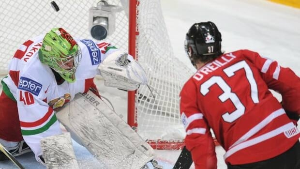 Team Canada forward Ryan O'Reilly flips the puck past netminder Dmitri Milchakov in a 5-1 romp over Belarus on Tuesday.