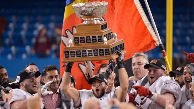 The Laval Rouge et Or celebate with the Vanier Cup after defeating the McMaster Marauders 37-14 in the 48th Vanier Cup in Toronto on Friday, Nov. 23, 2012.