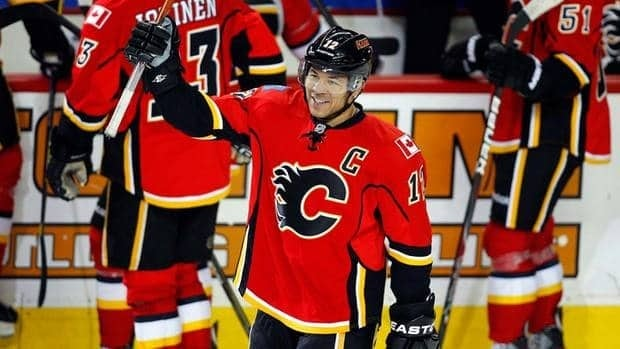 Jarome Iginla salutes the Calgary crowd after scoring his 500th career goal Saturday night against the Minnesota Wild.