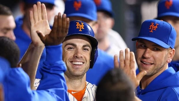 David Wright celebrates with his teamates in the third inning Wednesday after passing Ed Kranepool as the Mets' all time hits leader with 1,419.