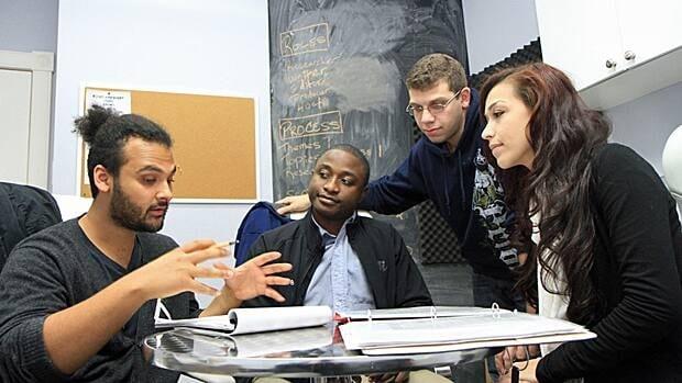 Tristan Raghunan, Don Mahleka, Amr Abdel-Latif and Gonca Aydin discuss Revolutionary Lives, a youth mental health radio show airing Nov. 5 on 93.3 CFMU. (Samantha Craggs/CBC)
