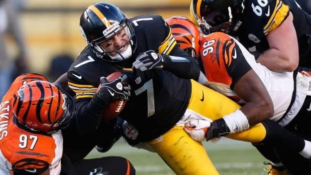 Pittsburgh Steelers quarterback Ben Roethlisberger is tackled during the fourth quarter against the Cincinnati Bengals on Sunday as Pittsburgh's playoff hopes were dashed with their loss.
