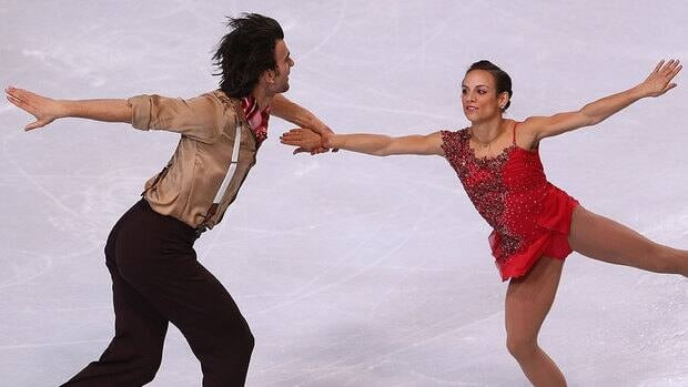 Canada's Meagan Duhamel and Eric Radford perform in Friday's pairs short program at the Trophee Eric Bompard in Paris. Duhamel fell on a landing after poorly executing a triple lutz.