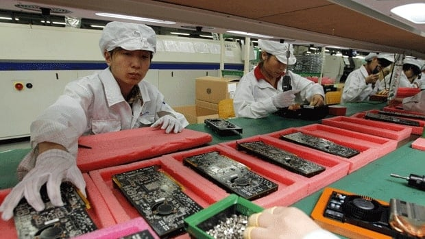Workers assemble electronics at the factory of a third-party contractor in China. All but four of the final-assembly factories affected by Apple's new guidelines are operated by such contractors.