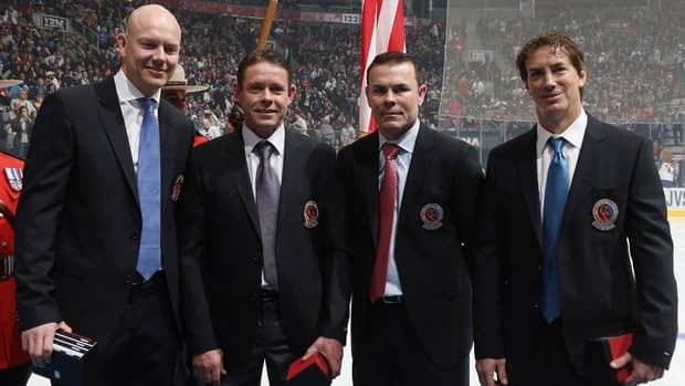 Mats Sundin, Pavel Bure, Adam Oates, and Joe Sakic are presented with Hall of Fame jackets prior to the Hockey Hall of Fame Legends Game at the Air Canada Centre on Sunday in Toronto.