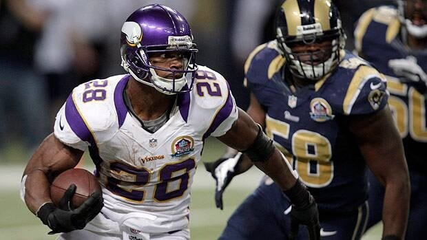 Minnesota Vikings running back Adrian Peterson, left, runs past St. Louis Rams outside linebacker Jo-Lonn Dunbar on his way to a 52-yard touchdown run on Sunday.