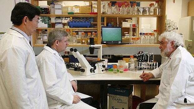 Prime Minister Stephen Harper is pictured at the National Microbiology Laboratory in Winnipeg in 2009. On Thursday, his government announced renewed funding for pharmaceutical research.