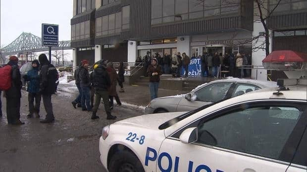 Students block the entrance to the Montreal offices of the Quebec Department of Education. They said they would stay there until the Charest government dropped plans to increase tuition fees.