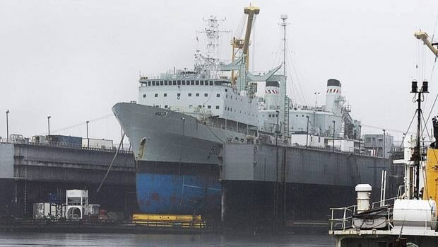 The navy supply ship HMCS Preserver, shown sitting at dry dock in 2010, leaked fuel into a Halifax harbour for five hours last year, according to a final report into the spill.