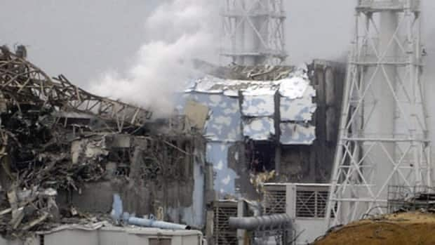 Smoke rises from the badly damaged Unit 3 reactor, left, at the Fukushima Daiichi nuclear complex in Okuma, northeastern Japan. The emergency command centre at the plant shook violently when hydrogen exploded at Unit 3, causing the plant chief to shout, 'This is serious, this is serious,' videos recently released by the Tokyo Electric Power Co. reveal.