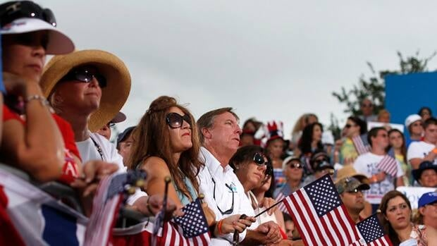 An eager audience listens to Republican presidential nominee Mitt Romney speak during a campaign rally in Port St. Lucie, Fla., on Sunday.