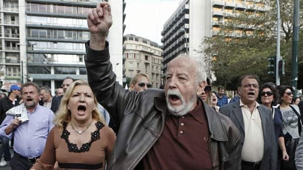 Greek bank employees protest against planned changes in their pension fund in Athens Wednesday. In spite of years of harsh spending cuts, Eurozone government debt is at its highest level since 1999.