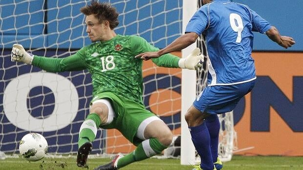 Canada goalkeeper Michal Misiewicz blocks a shot by Isidro Gutierrez of El Salvador, in the first half of a CONCACAF Olympic qualifying soccer match on Thursday in Nashville.