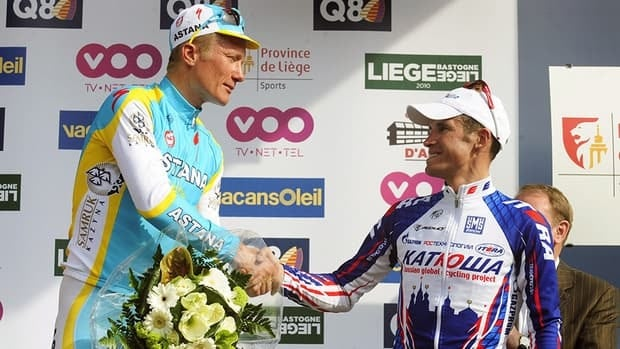 Kazakhstan's Alexander Vinokourov of team Astana, left, shakes hands with Russian Alexander Kolobnev of team Katusha on the podium at the end of the 96th edition of the one day cycling race Liege-Bastogne-Liege, 258 km from Liege to Ans, on April 25, 2010. The UCI is now looking into whether bribery helped Vinokourov win the race.