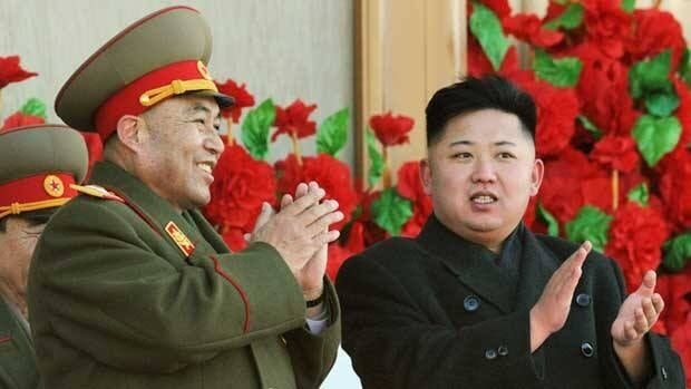 North Korean leader Kim Jong-un (right) smiles during a military parade on Feb. 16, 2012. The Korea peninsula has technically been at war for 60 years.